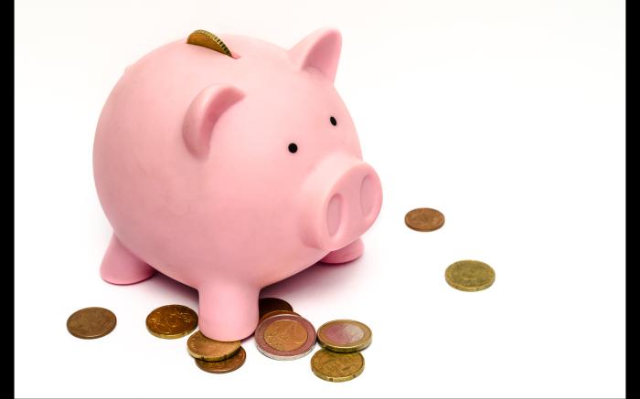 pink piggybank with gold coins